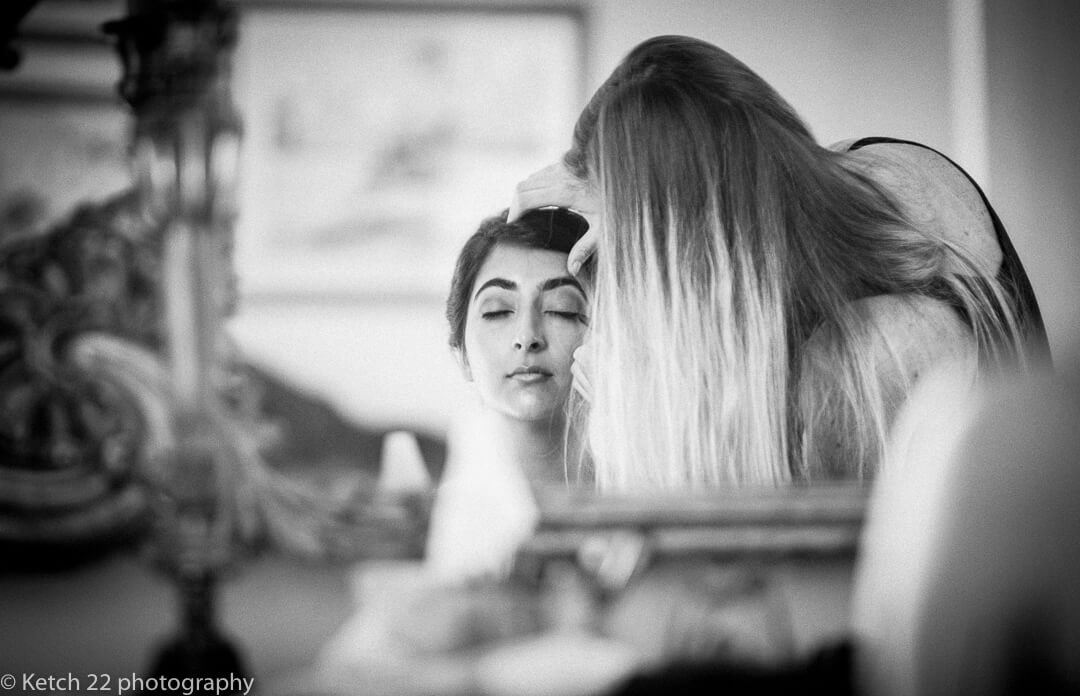 Indian bride getting ready for wedding at Highclere castle