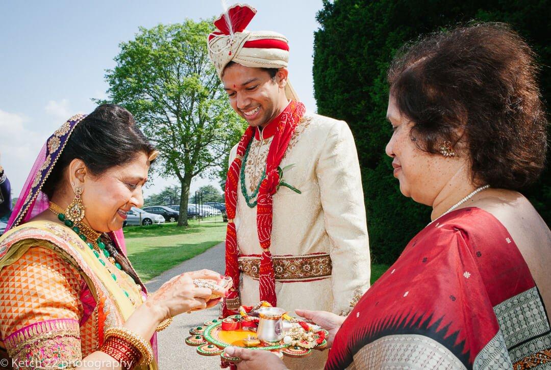 Groom attending Indian wedding customs