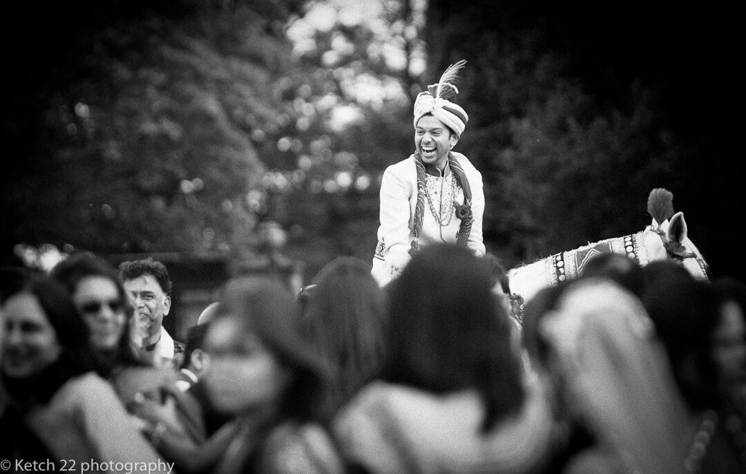Indian groom on horseback at hindu wedding