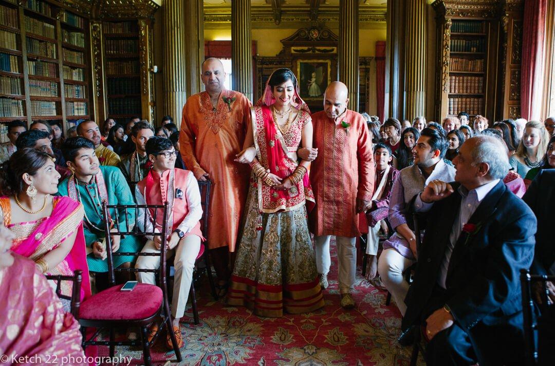 Bride enters hindu wedding ceremony at Highclere Castle