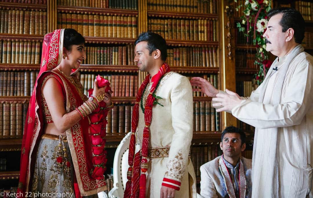 Bride and groom looking at eachother at hindu wedding ceremomy