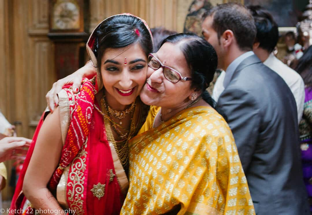 Bride hugs grandma in yellow dress