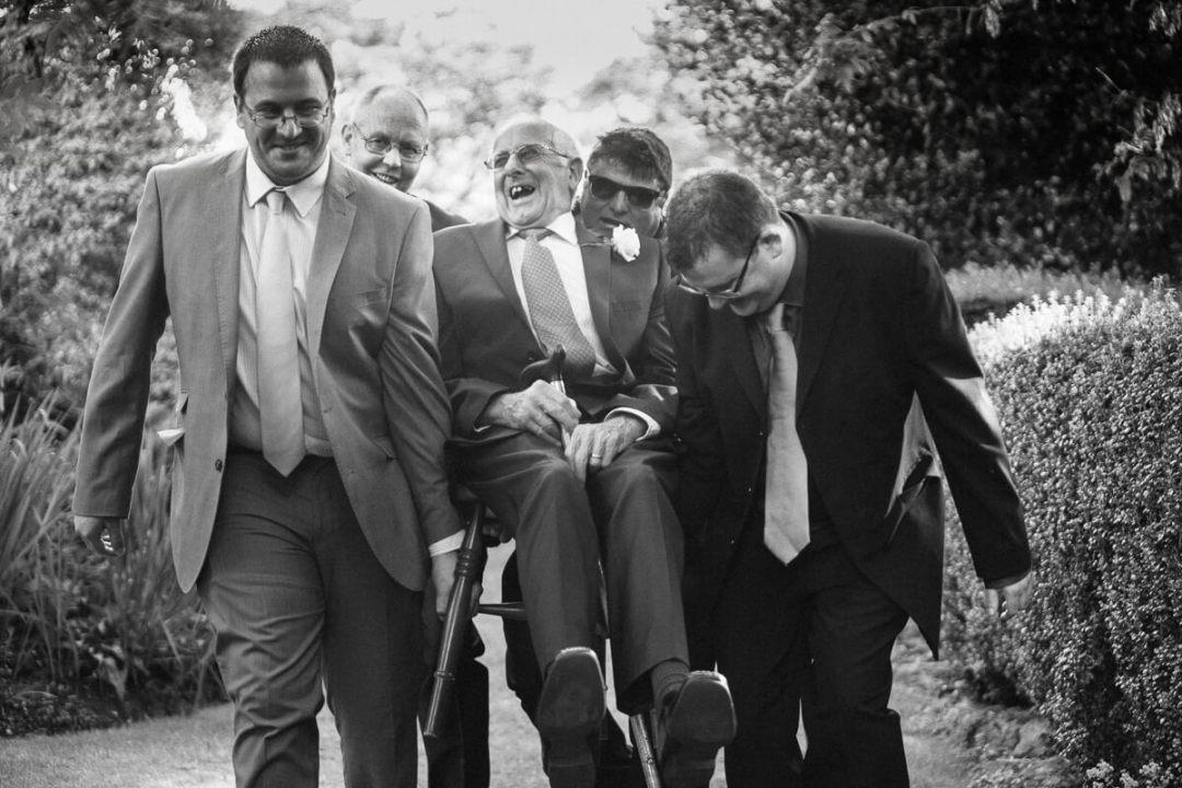 Laughing grandad at Gloucestershire Wedding