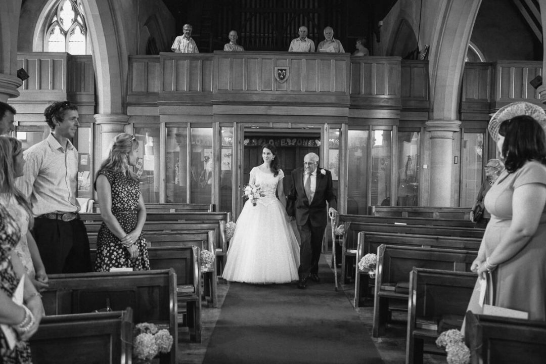 Bride and father entering church wedding