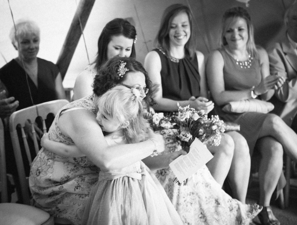Bridesmaids hugging at wedding ceremony in Shropshire