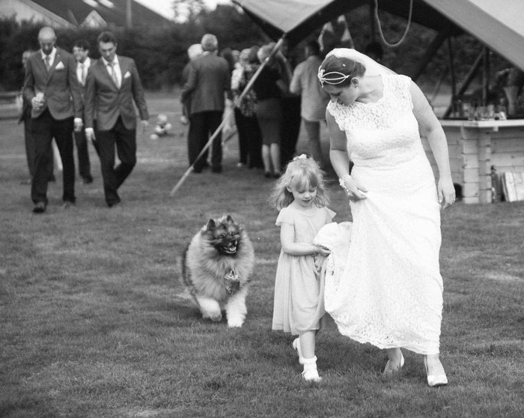 Bride walking with her daughter and dog at wedding in Shropshire