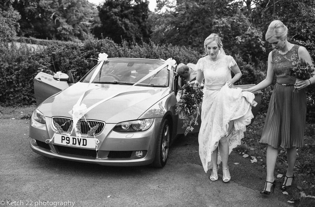 Bride leaving wedding car just before church ceremony