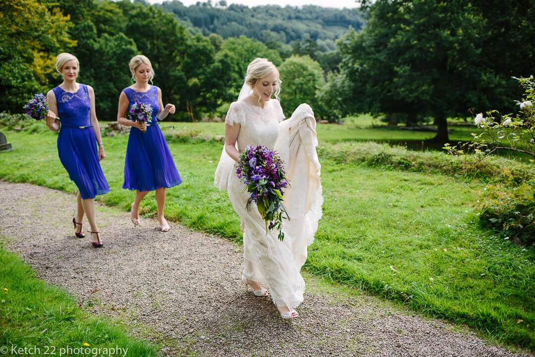 Bride walking along church path just before wedding