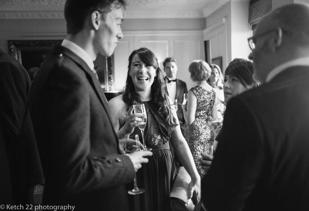 Wedding guests chatting at Foxhall Manor