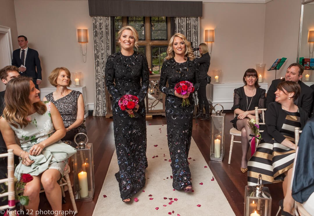 Bridesmaids in black at winter wedding
