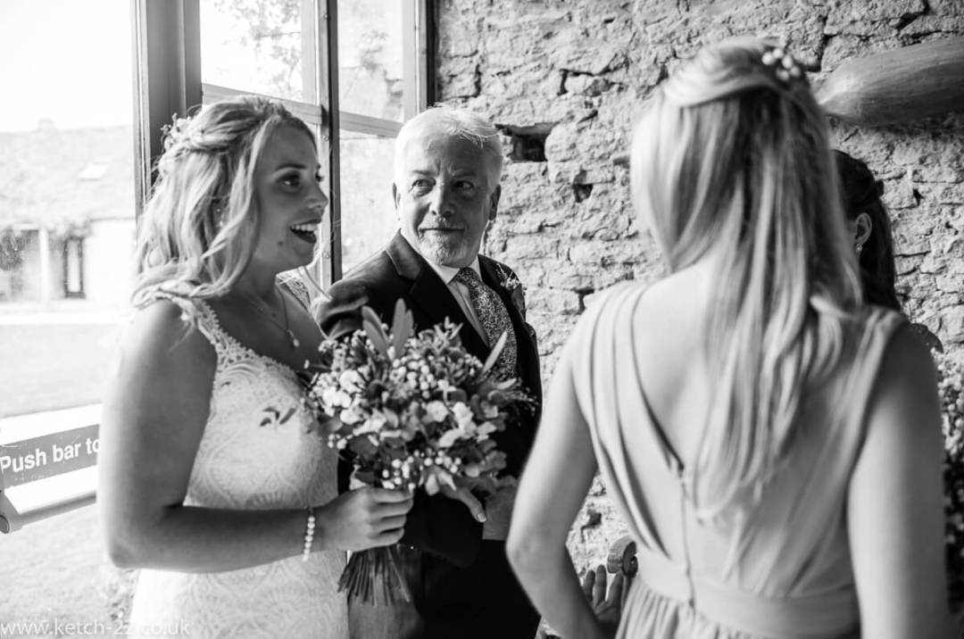 Father of bride looks at his daughter before wedding ceremony