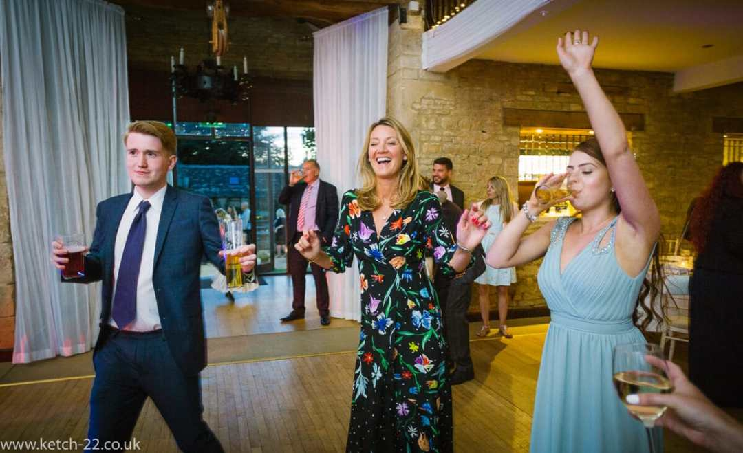 Wedding guest dancing at reception