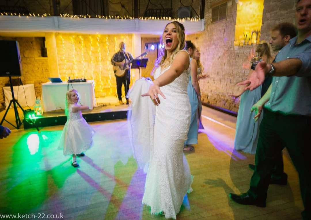 Bride going crazy on dance floor at The great Tythe Barn Wedding