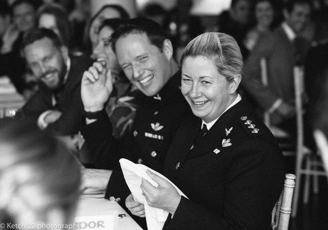 Wedding guests in army uniform laughing