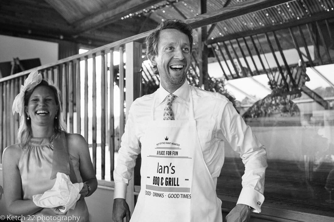 Wedding guest gets ready to carve beef at Cripps Stone Barn