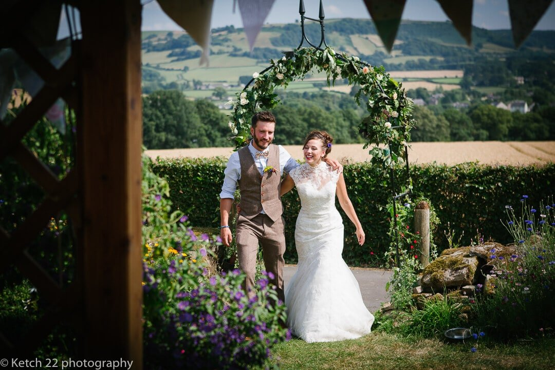 Bride and groom entering wedding Yurt