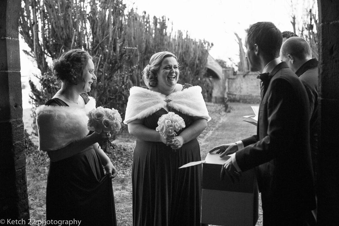 Bridesmaids waiting in Church door just prior to wedding ceremony