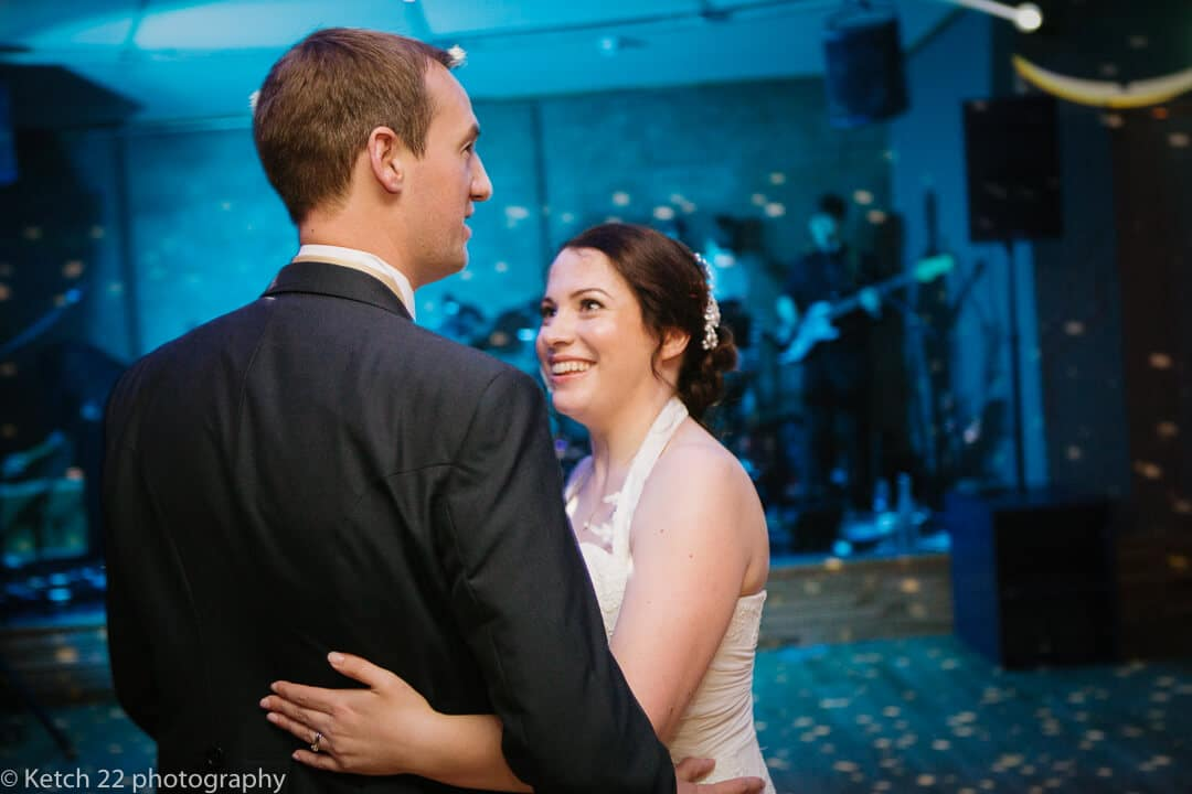 Bride and groom having first dance in blue light