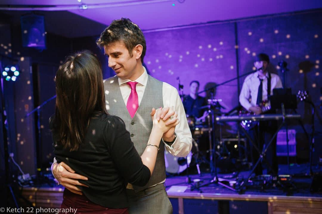Wedding guests slow dancing at wedding