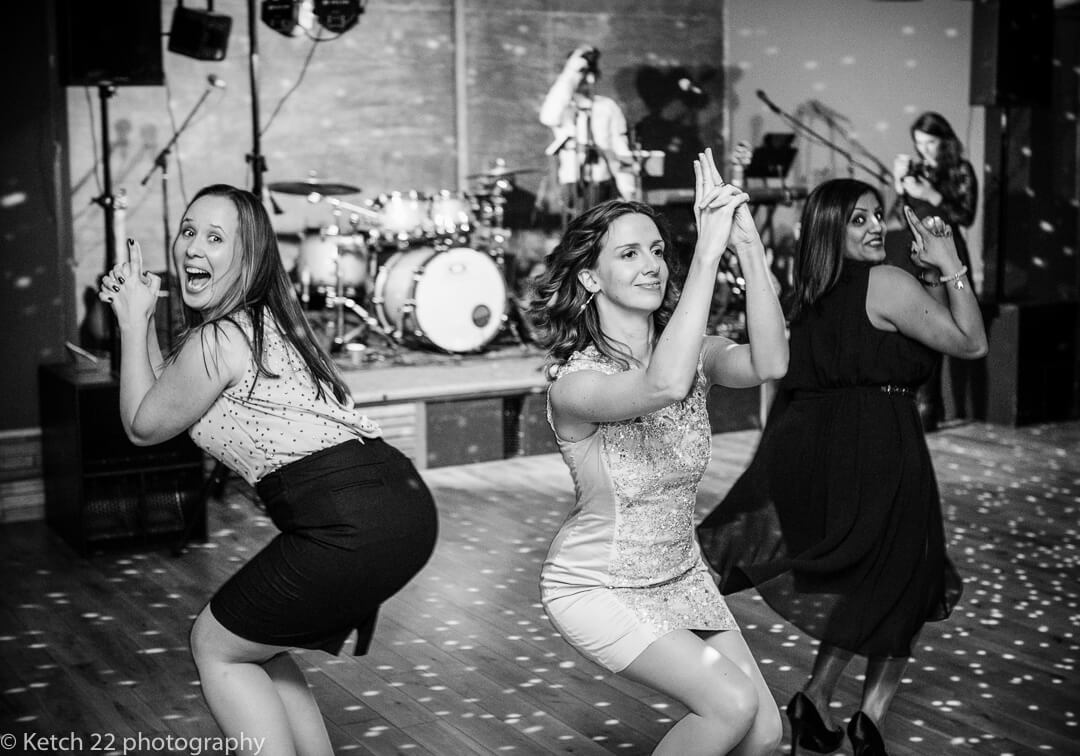 Girls pretending to be Charlies Angels at Elmore Court wedding