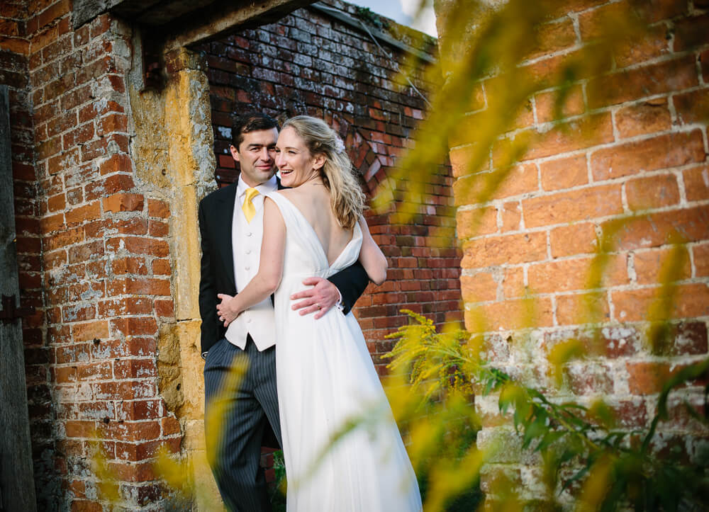 Bride and groom in walled garden at Gloucestershire wedding