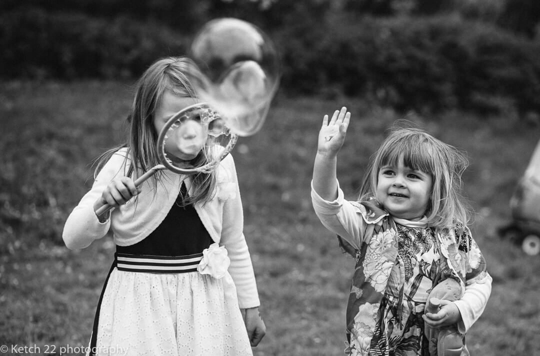 Kids playing with bubbles at Gloucestershire wedding