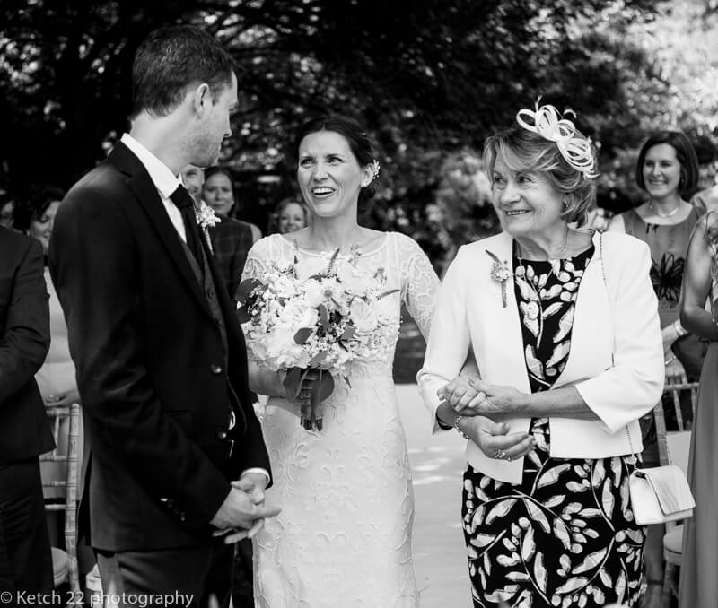 The first look at wedding ceremony at The Swan at Bibury Gloucestershire