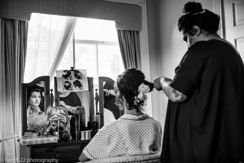 Bridesmaid having hair done at Dorset Sumer wedding