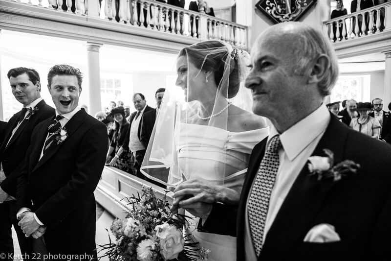Groom takes first look at Bride at Dorset summer wedding