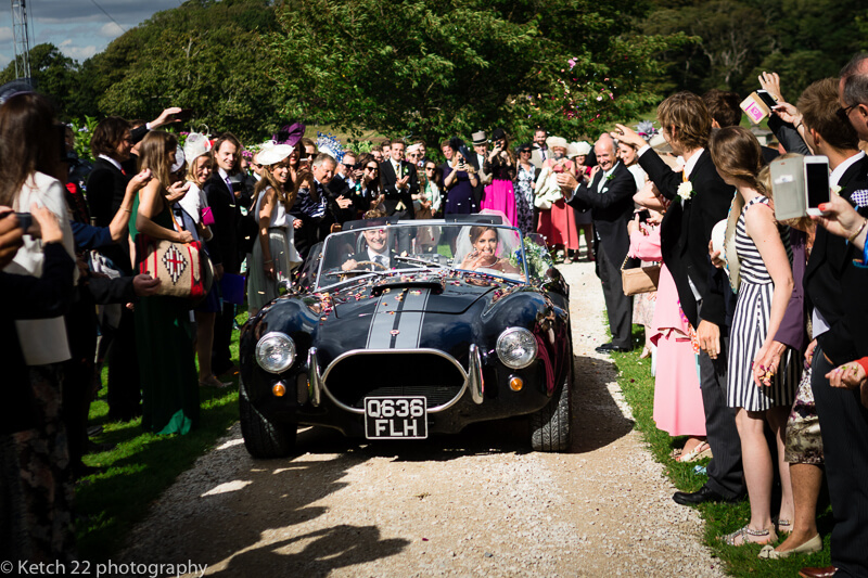 wedding confetti thrown on sporty car in Dorset