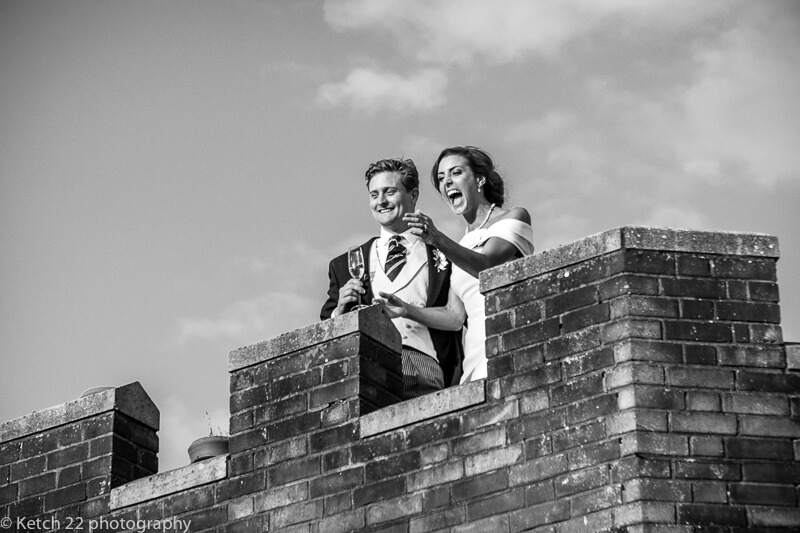 Bride and groom on roof top at Dorset Summer wedding