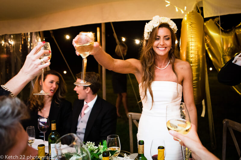 Bride toasting at Dorset summer wedding