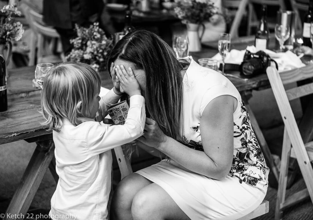 Mother and son playing at Marquee wedding
