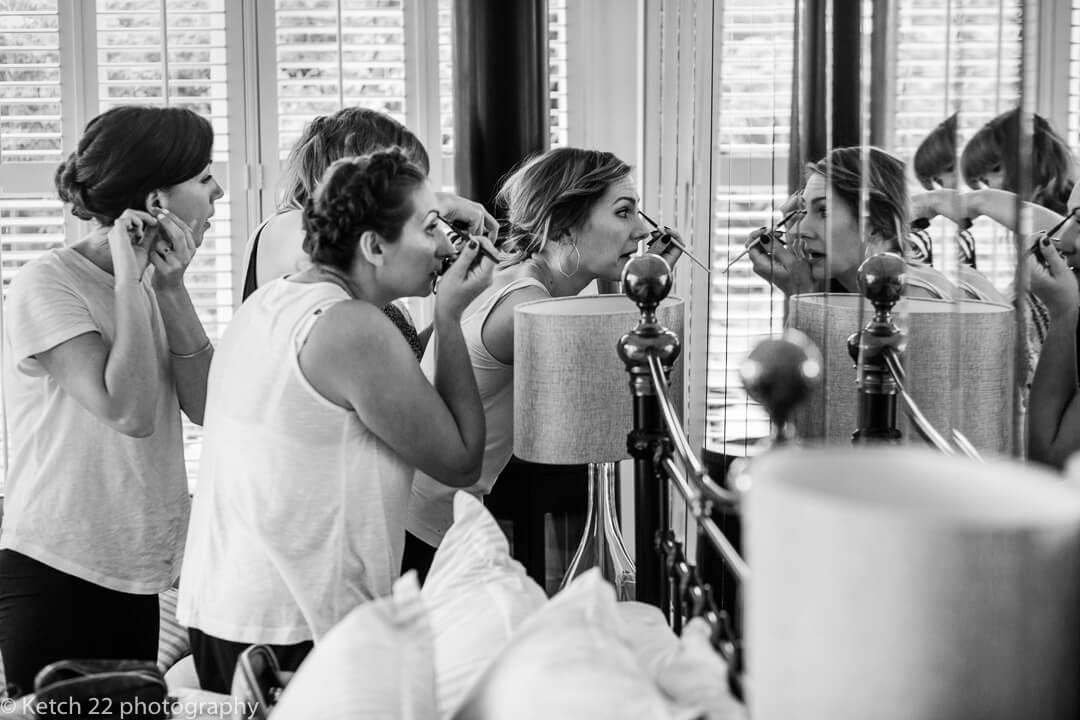 Story telling wedding photography of bridesmaids getting ready during the preparations