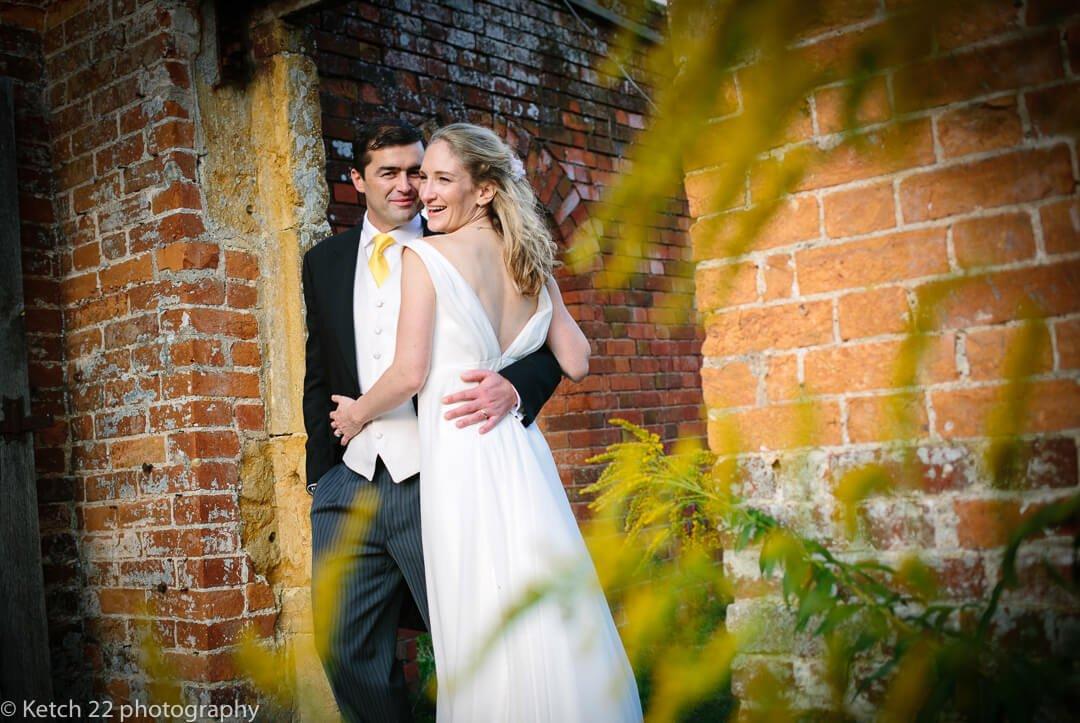 Portrait of bride and groom in garden at summer wedding