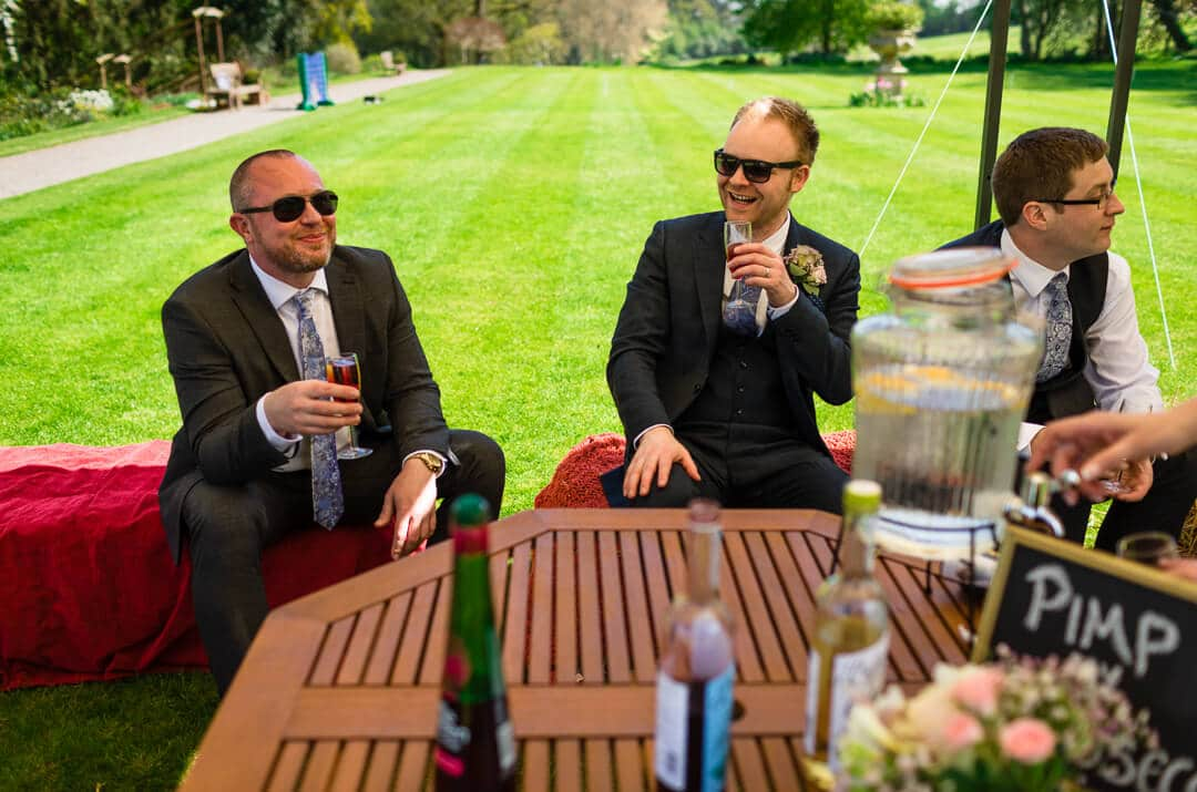 Relaxed guests enjoy a drink at Homme House wedding