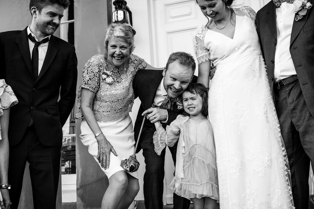 Fun moment with groom and little girl at country house wedding
