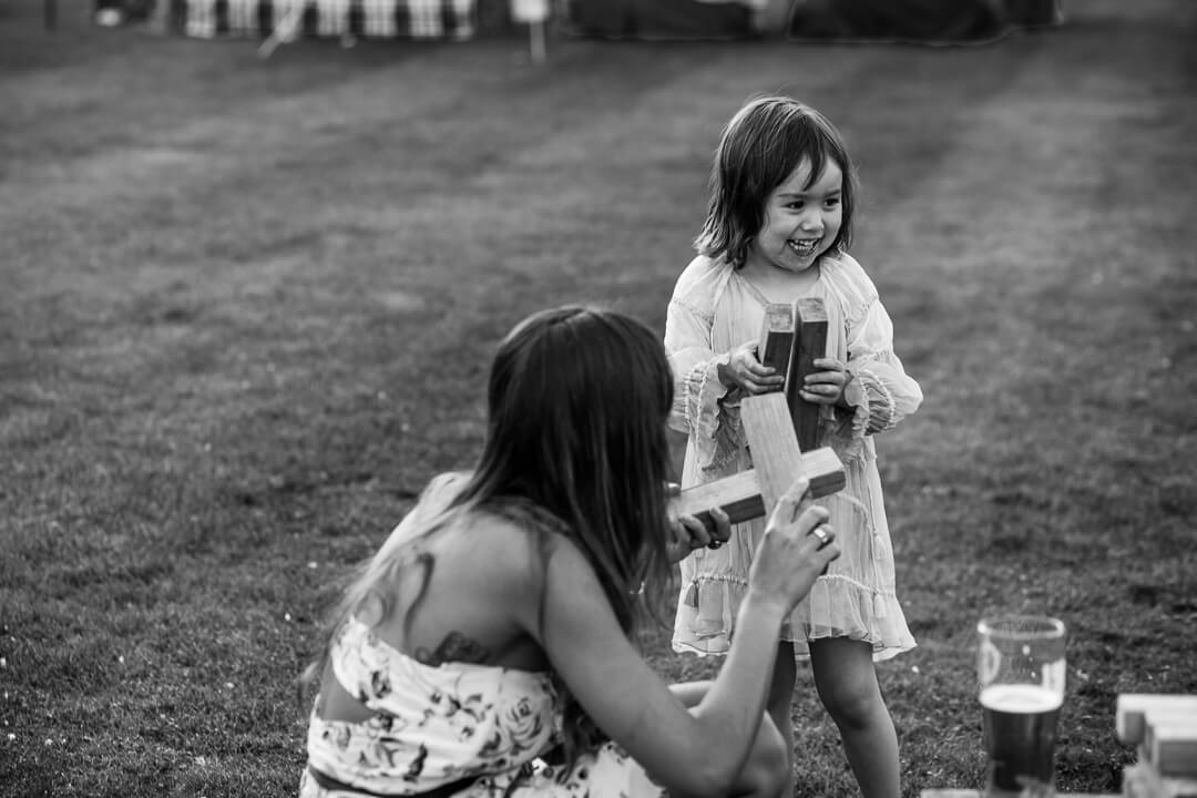 Little girl laughing at summer wedding