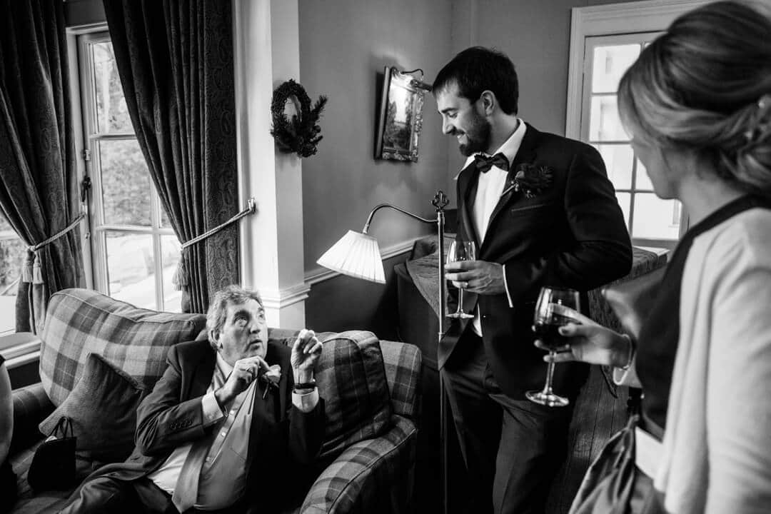 Reportage wedding photo of guests chatting