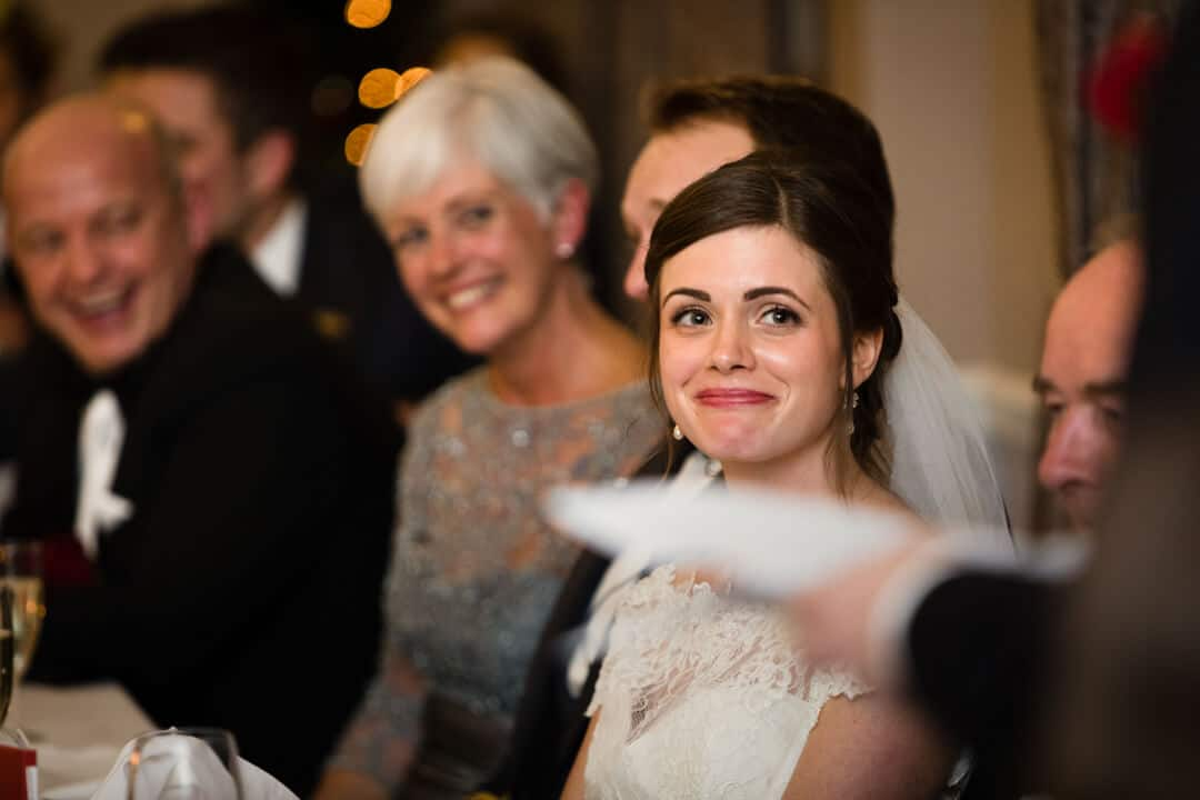 Bride listening to her dad making wedding speech