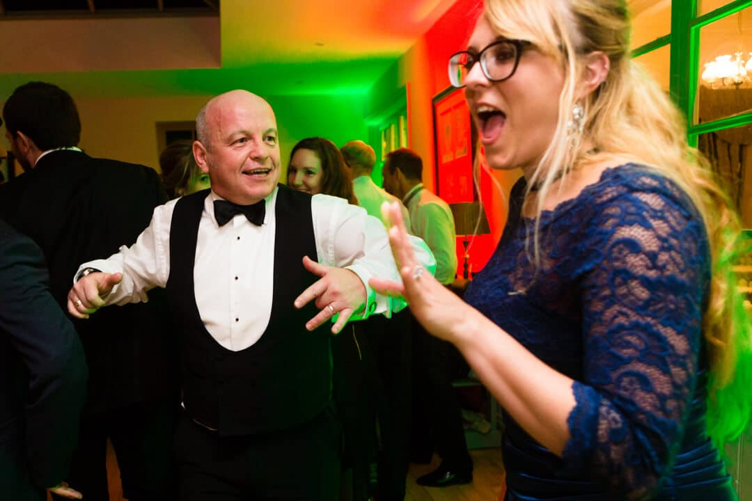 Father of groom dancing at wedding reception