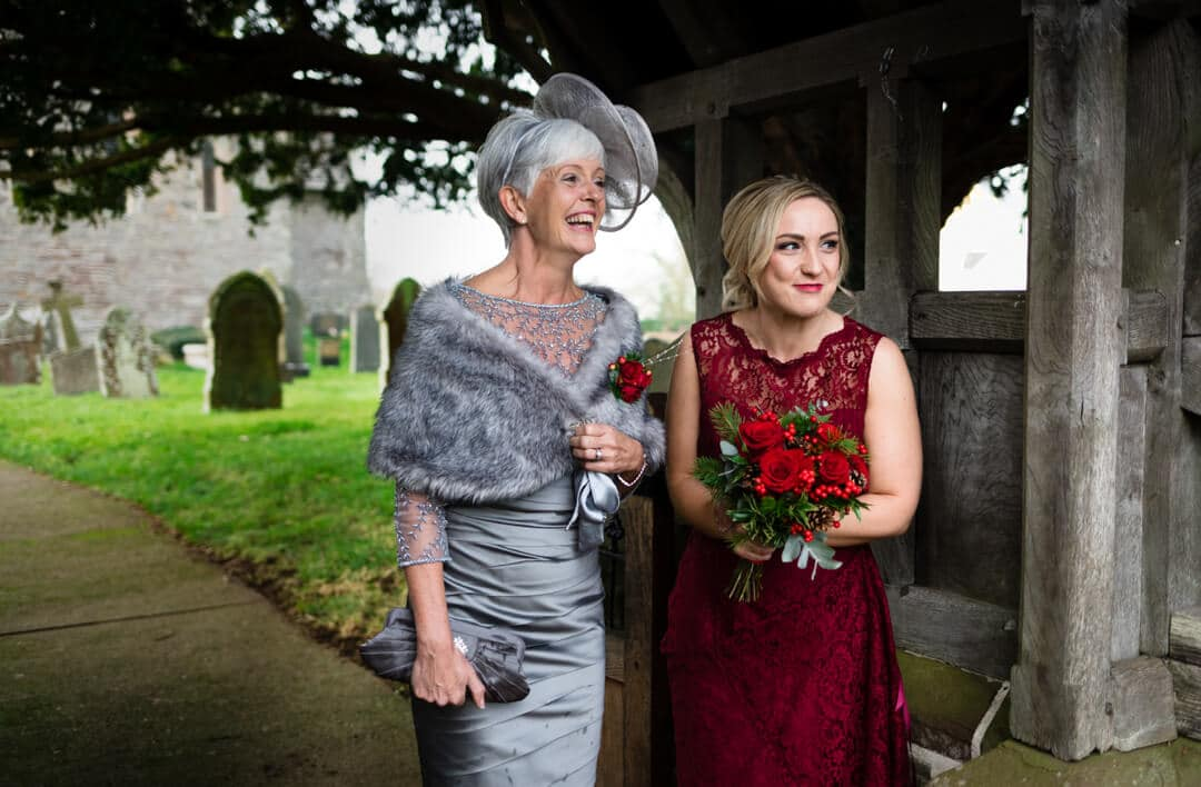 Mother and bridesmaid waiting for bride to arrive