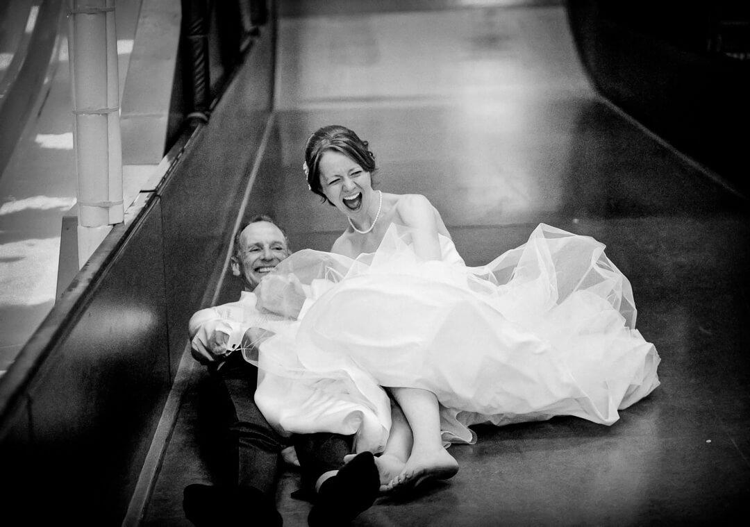 Bride on big slide for Herefordshire wedding photographer page