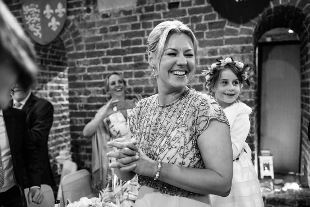 Bridesmaid laughing at wedding reception