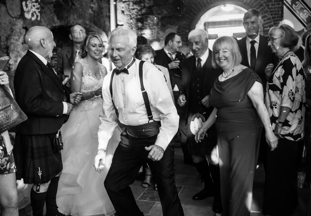 Father of bride dancing at wedding reception