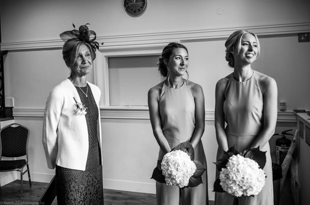 Mother and bridesmaids at wedding ceremony