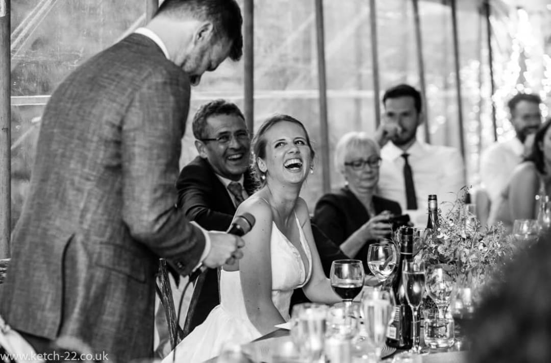 Bride reacting to grooms wedding speech