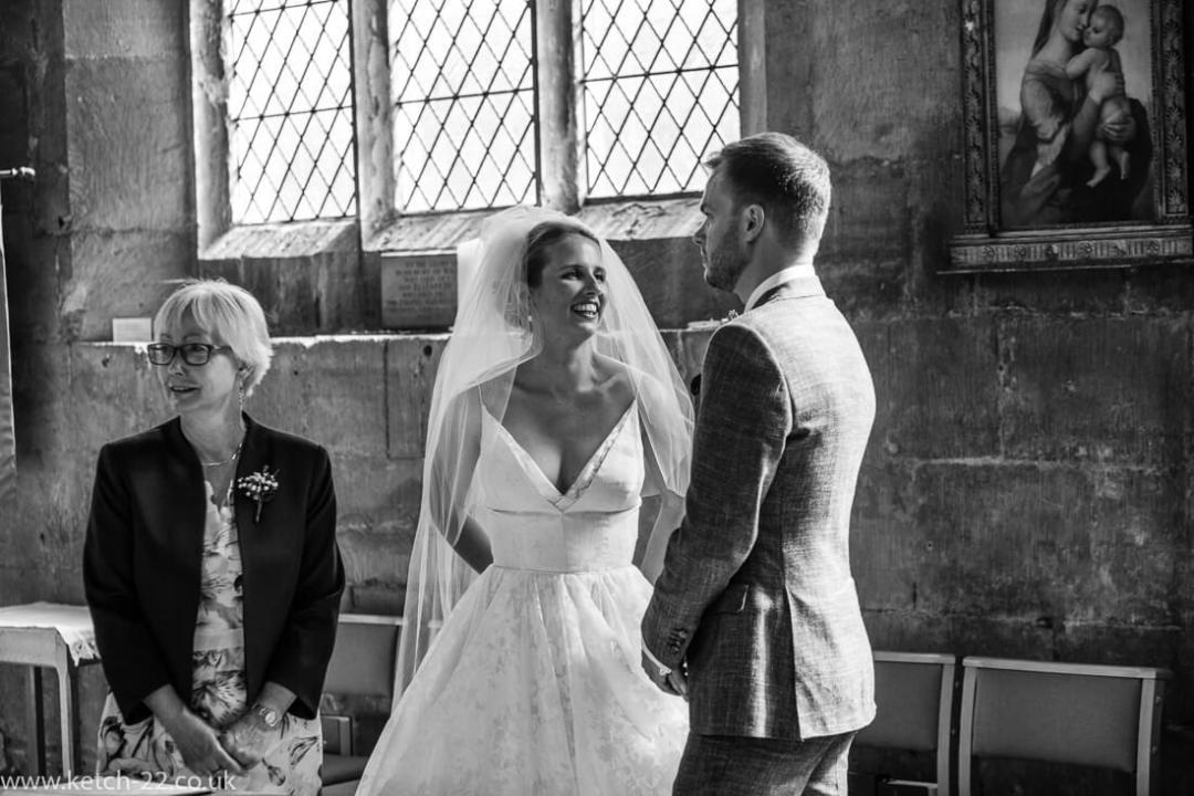 Bride looking into grooms eyes at wedding ceremony