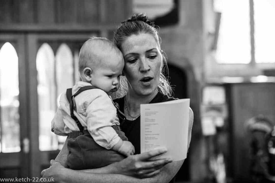Mother and baby singing at wedding