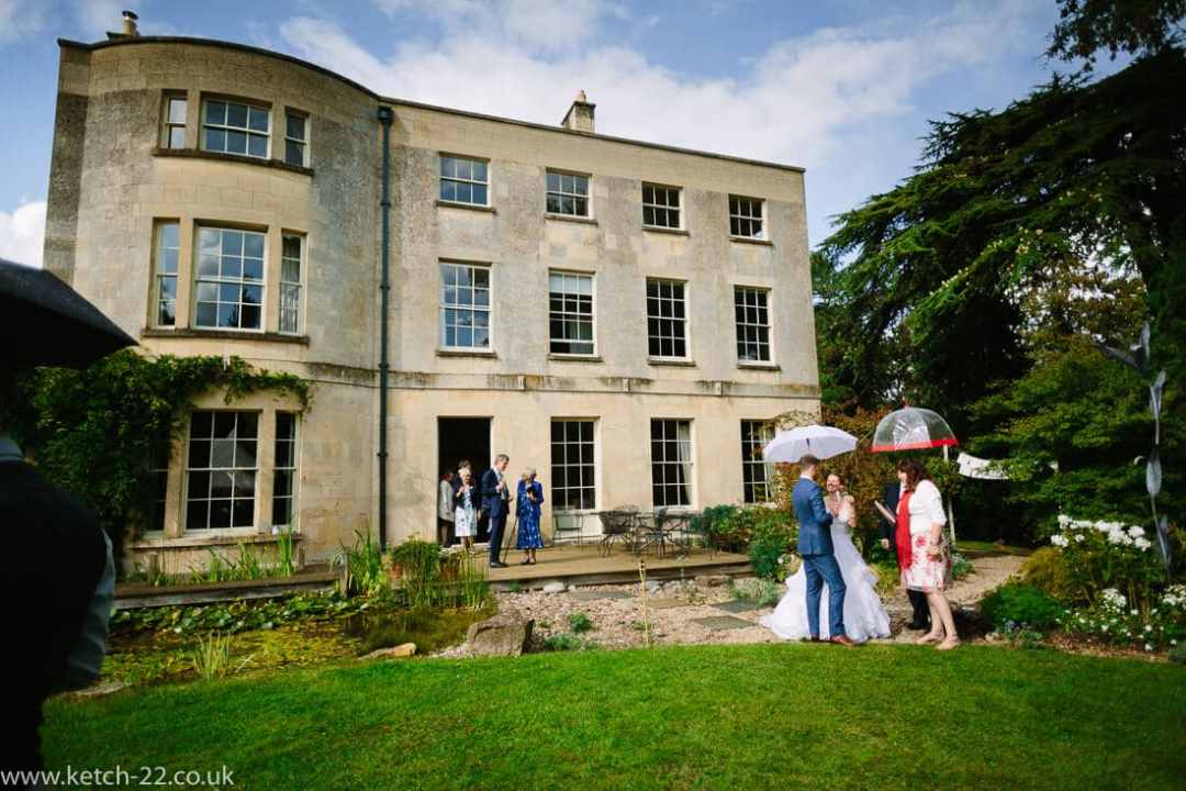 Wedding guests at country house reception